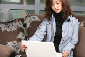 Chinese woman working on laptop